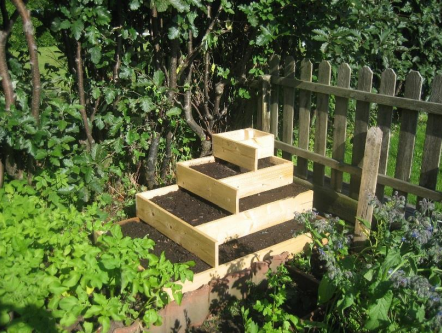 Tiered garden box for efficient vegetable growing